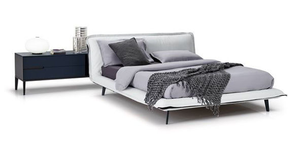 Picture of Natuzzi Italia Piuma king bed frame in warm white leather with grey fabric ruffle.