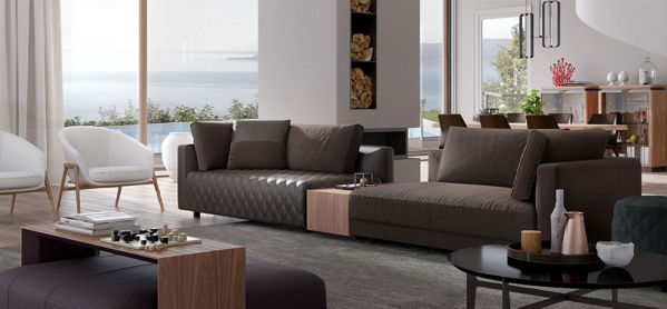 Picture of Natuzzi Italia Melpot sectional consisting of white leather, wooden cabinet and custom cushions.